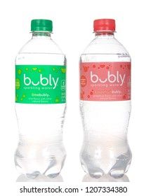 Alameda, CA - October 02, 2018: Bottles of Bubly flavored water. Lime and grapefruit flavors, isolated on white background. The NEW  Bubly sparkling water line was created by PepsiCo.