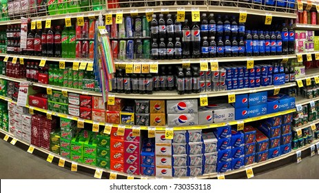 Alameda, CA - October 08, 2017: Grocery store shelf with various brands of soda in cans. Pepsi Co is one of the largest corporations in the non-alcoholic beverage industry.