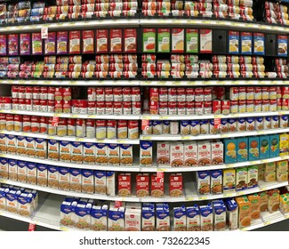 Alameda, CA - October 10, 2017: Grocery store aisle with cans of campbell's brand soup and various brands boxed broth. Campbell's products are sold in 120 countries around the world.