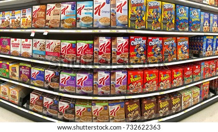 Alameda, CA - October 10, 2017: Grocery store aisle with boxes of various brands of breakfast cereal.