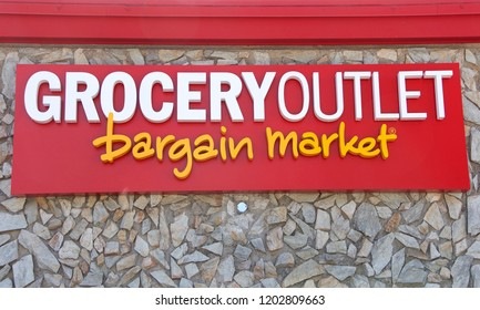 Alameda, CA - October 11, 2018: Close up on sign store front Grocery Outlet Bargain Market. A supermarket company that offers discount, overstocked and closeout products.