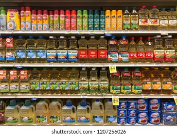 Alameda, CA - October 18, 2018: Grocery store shelves with bottles and cans of cooking and seasoning oils in various forms and flavors.