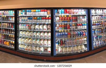 Alameda, CA - October 18, 2018: Dairy isle in grocery store with milk in various flavors and sizes. Milk is one of the most popular items in a supermarket.