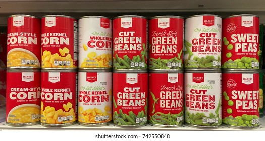 Alameda, CA - October 26, 2017: Grocery store shelf with cans of Market Pantry brand vegetables. Corn, peas and green beans.
