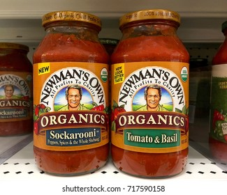 Alameda, CA - September 13, 2017: Grocery shelf with jars of Newman Own Organics pasta sauce. The company gives 100% of the after-tax profits from the sale of its products to Newman's Own Foundation.