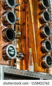Alameda, California - July 17, 2018: Copper and stainless steel distillation and fermentation tanks at vodka brewery.