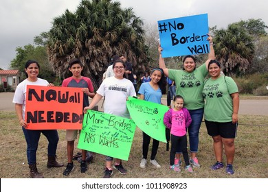 Alamo, Texas / USA - Jan. 17, 2017:  A Hispanic family protests at a demonstration against the building of a border wall through the Santa Ana National Wildlife Refuge in the Rio Grande Valley.