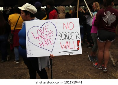 Alamo, Texas / USA - Jan. 27, 2017:  A Hispanic woman holds a sign protesting the building of a border wall through the Santa Ana National Wildlife Refuge on the Rio Grande River in far south Texas.