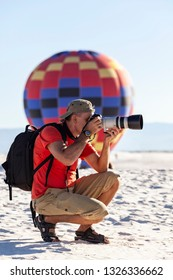 ALAMOGORDO, NEW MEXICO - SEPTEMBER 19, 2010:  Photographer takes a picture at The White Sands monument during the hot air balloon festival