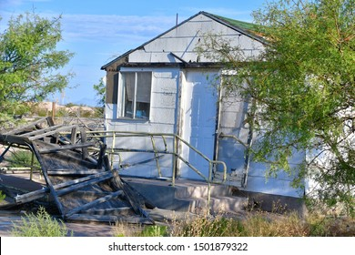 Alamogordo, New Mexico / USA Circa September 2019 Spooky and deserted old ranch house. When the wind blows you can hear all sorts of clatter and noise from the house. A sad sight to see, broken dreams