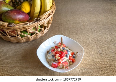 Alamy Bowl of oat cereal and fresh strawberries, blackberries and cinnamon with fruits in background