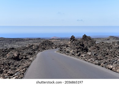 Alamy A road through Fire mountains in Timanfaya National Park, Lanzarote, Canary Islands, Spain