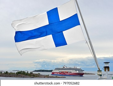 ALAND ISLANDS, FINLAND - SEPT 2, 2017: National flag of Finland on background of Ferry Viking Line and Aland Islands