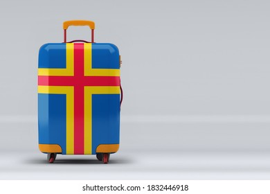 Aland Islands national flag on a stylish suitcases on color background. Space for text. International travel and tourism concept. 3D rendering.
