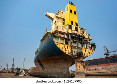 Alang ,Bhavnagar ,01, February,2016: Low  wide angle view showing  dismantled and remaining  part of the   cut ship with background of Alang Ship Breaking Yard, Bhavnagar, Gujarat, India,Asia