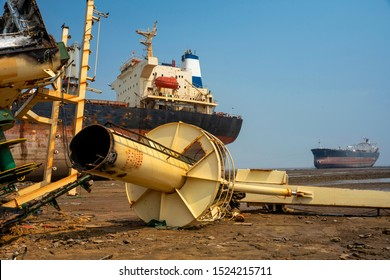 Alang ,Bhavnagar ,01, February,2016:  Low angle close up of dismantled metal scrap parts from ship with Arabian sea background  at Alang Ship Breaking Yard,Bhavnagar, Gujarat,  India, Asia