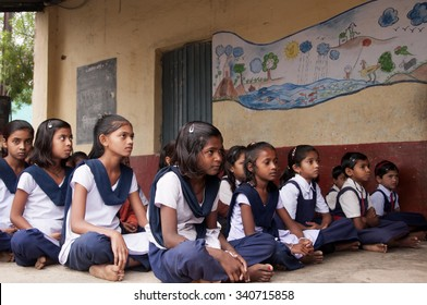 ALANGAON, MAHARASHTRA, INDIA - February 22, 2014: Happy Indian rural girl at their school, Alangaon, Amravati , Maharashtra, India