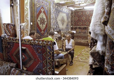 ALANYA, ANTALYA - AUGUST 16, 2008 :Sellers Cask in a carpets store.Authentic oriental store
