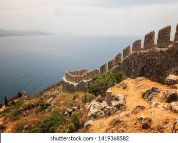Alanya Castle fortress wall and Mediterranean Sea in Alanya harbor. Alanya, Antalya, Turkey