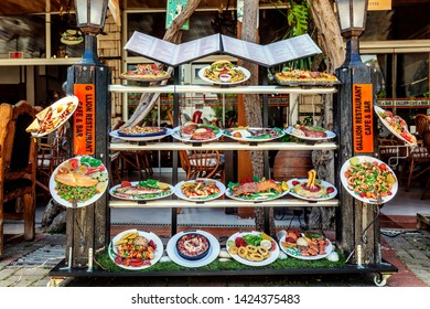 Alanya, Turkey, 05/07/2019: Dummies of dishes from the restaurant menu on the shop window in the street.