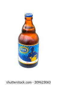 ALANYA , TURKEY - AUGUST 21, 2015:Efes Pilsener glass of bottle beer, Efes Pilsener is the flagship product of this company and the most popular beer in Turkey.