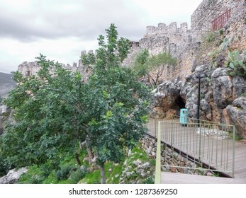 ALANYA, TURKEY - DECEMBER 11 2018: Climbing the Alanya Peninsula. Walk to the fortress of Alanya. Authentic buildings, ruins and nature