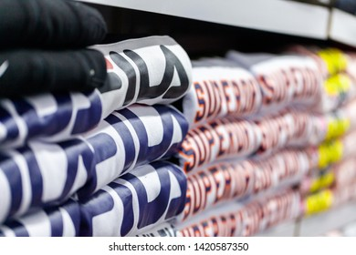 ALANYA / TURKEY - JUNE 1, 2019: Clothes from Fila and Superdry lies in a clothing store in Alanya, Turkey.