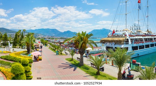 Alanya, Turkey - June 23, 2017: Aerial view of seafront and sightseeing ships in popular seaside resort city Alanya, Turkey