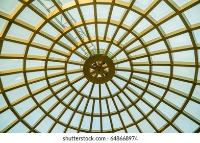 Alanya, Turkey - May, 3, 2017: Transparent glass dome of a modern hotel. Metal frame frame, glass through which the blue sky is visible and illuminates the lobby of the hotel or business center.