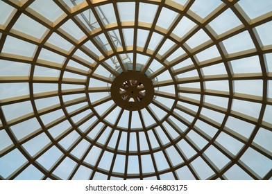 Alanya, Turkey - May, 5, 2017: Transparent glass dome of a modern hotel. Metal frame frame, glass through which the blue sky is visible and illuminates the lobby of the hotel or business center.