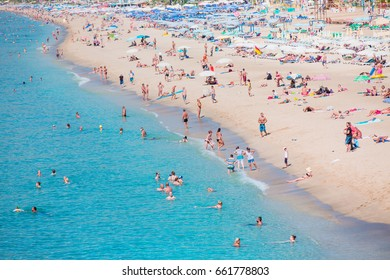 ALANYA, TURKEY - OCTOBER 03, 2016:: Holidaymakers sunbathing at Cleopatra beach . One of the beaches of the Mediterranean coast