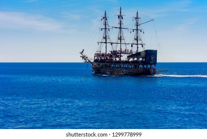 Alanya, Turkey - October 05, 2018. A large sailing ship in a pirate style in the open sea against a blue sky. Photos of the ship from the sea. The concept of summer holidays, sports, tourism