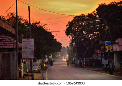 Alappuzha, India - March 01, 2018: Early morning sunrise over a narrow street.