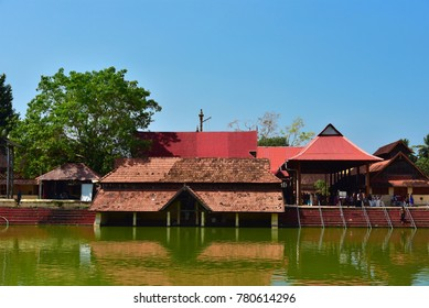 ALAPPUZHA, KERALA, INDIA, DECEMNER 17, 2017: Ambalappuzha Sree Krishna Swamy Temple, a famous Hindu pilagrimage centre, with the temple pond in the foreground on a sunny day.