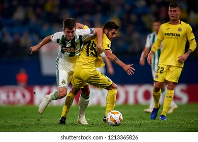 Alar of Rap Wien  and Llambrich of Villarreal battle for the ball during the match of the Europa League between Villarreal CF and Rapid Wien at La Ceramica Stadium Villarreal, Spain on October 25 2018
