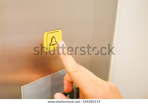 Alarm button with business man hand trying to press in the elevator, safety first and security background concept