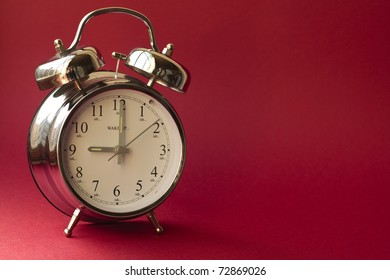 Alarm clock against a red background