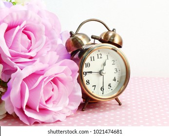 alarm clock with artificial roses flower bouquet