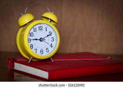 Alarm clock and book.
