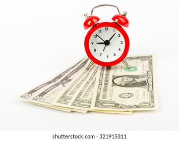 Alarm clock with cash on isolated white background