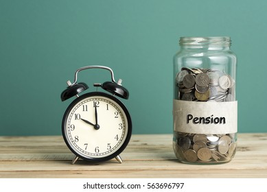 Alarm clock and coins with Pension word in jar - Business Concept