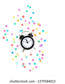 alarm clock and colorful confetti. Top view. alarm clock and colorful confetti isolated on white background. concept party, festive decor. Minimal styled holiday time concept. copy space.