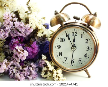 alarm clock with dried flower bouquet