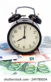 alarm clock and euro bills. time for money concept
