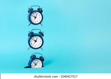 alarm clock falling into hole, abstract time concept