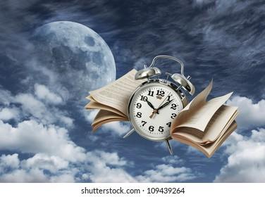 Alarm clock flying on moonlit night sky, time flies concept
