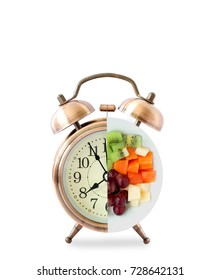 Alarm clock and fresh fruit .health care concept and healthy diet.on a white background