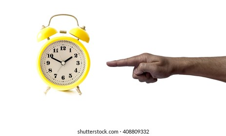 alarm clock with hand pointing at it isolated on white background showing time concept, time management, saving time