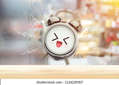 The alarm clock is happy in the morning at the bedroom. Good morning and Happy day. Have a good day concept.