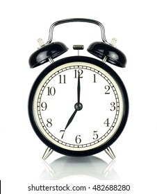 Alarm Clock isolated on white, in black and white, showing seven o'clock.